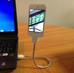 Une bobine une Un câble en guise de dock pour son iPhone!